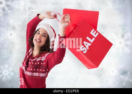 Image composite de belle brune montrant vente sac et panier Banque D'Images
