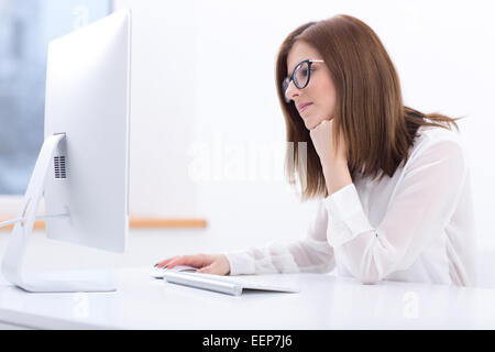 Young businesswoman working at office