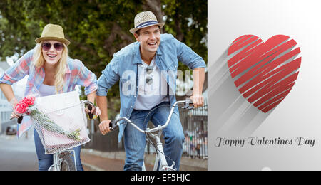 Image composite du hip young couple going for a bike ride Banque D'Images