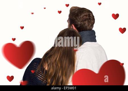 Composite image vue arrière du couple romantique Banque D'Images