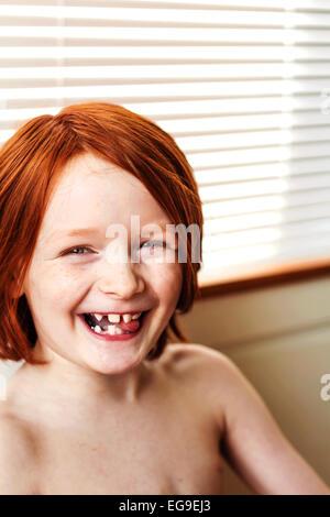 Portrait of smiling redhead boy Banque D'Images