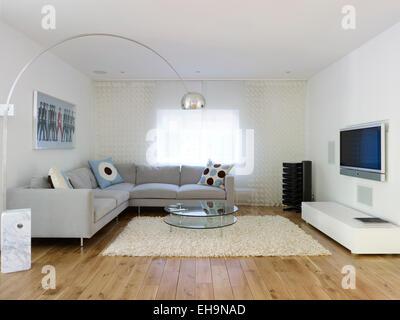 Canapé d'angle avec des coussins de salon moderne avec un éclairage design dans Radinden Manor Road home, UK Banque D'Images