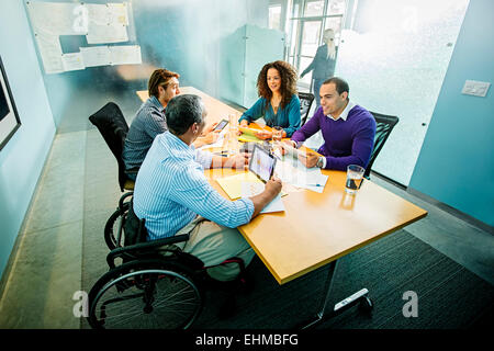 Business people using digital tablets in office meeting Banque D'Images