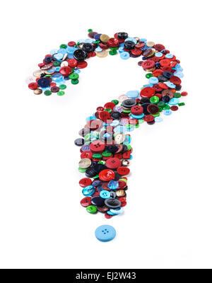 Beaucoup de boutons formés dans la forme d'un point d'interrogation.