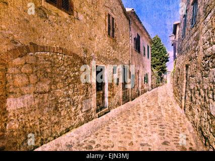 Style vintage photo d'une rue médiévale dans un vieux village toscan (tonique de droit avec effet grunge) Banque D'Images