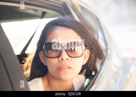 Woman looking out of Car Window Banque D'Images