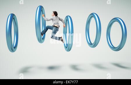 Caucasian man jump à l'intérieur de l'anneau 3d Banque D'Images