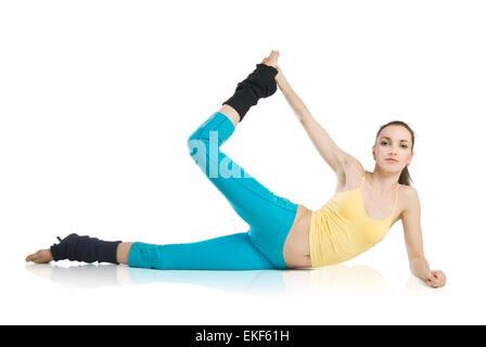 Beautiful Girl doing gymnastics sur fond blanc Banque D'Images