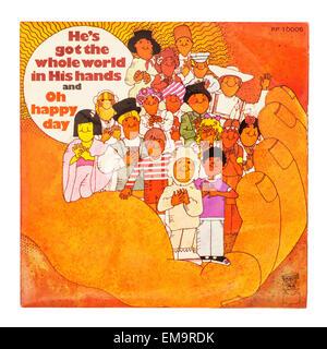 Une aire d'un disque vinyle appelé Il a le monde entier dans ses mains sur un fond blanc Banque D'Images