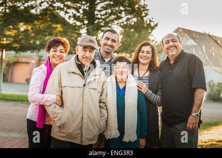 Multi-generation family smiling together outdoors Banque D'Images