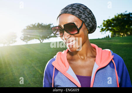 African American Woman wearing sunglasses in park