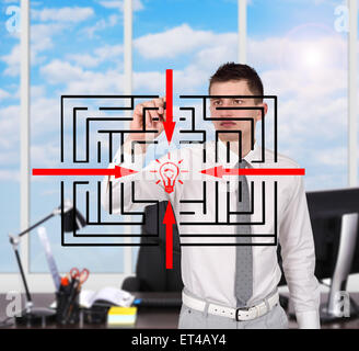 Young businessman in office labyrinthe dessin