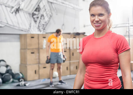 Portrait of happy woman standing in crossfit gym Banque D'Images