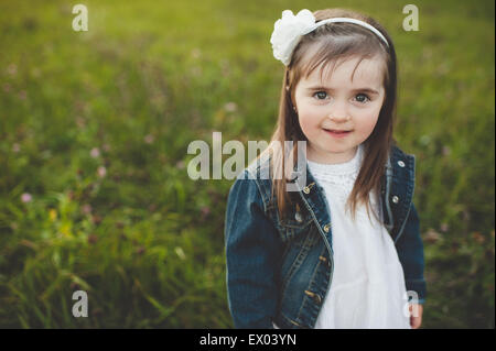 Portrait of young girl in field