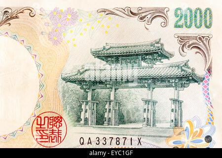 Détail de l'avers d'un billet de 2000 Yen japonais avec la valeur et l'image de l'Shureimon, une porte du xvie siècle au château de Shuri à Okinawa.