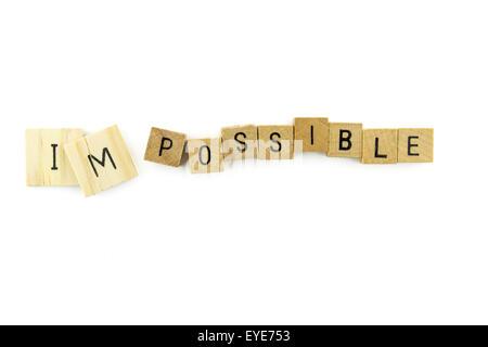 Impossible mot wooden alphabet blocks sur fond blanc en vue de dessus Banque D'Images
