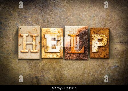 Le mot 'help' écrit en métal rouillé type typographique sur un vieux fond vieux cuir. Banque D'Images