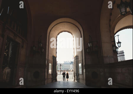 Caucasian couple standing in archway église