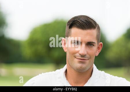 Close up of Caucasian man smiling outdoors
