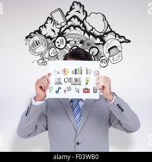 Composite image of businessman holding blank sign en face de sa tête