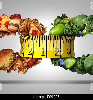 Régime alimentaire mesure de bande choix concept comme un symbole de vie nutrition en tant que groupe de fruits Banque D'Images