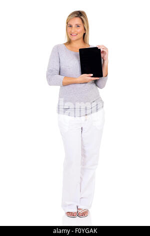 Happy pregnant woman presenting tablet computer Banque D'Images