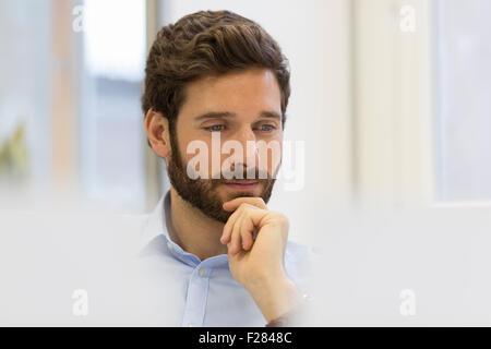 Pensive businessman in modern office