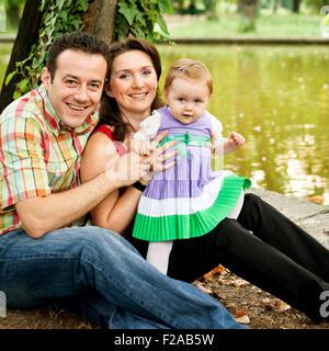 Heureux famille heureuse - mère-fille et père Banque D'Images