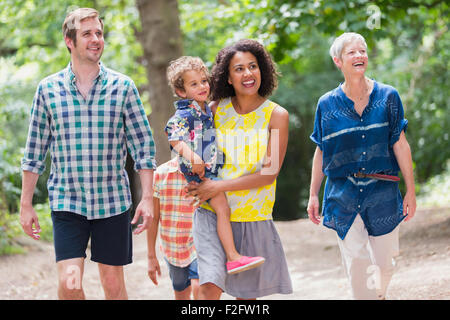 Multi-generation family walking in woods Banque D'Images