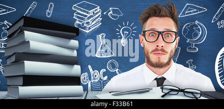 Image composite de geeky young businessman looking at camera Banque D'Images