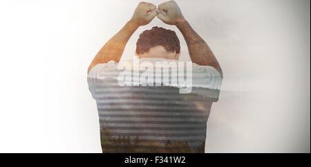 Image composite de colère man leaning on white background Banque D'Images