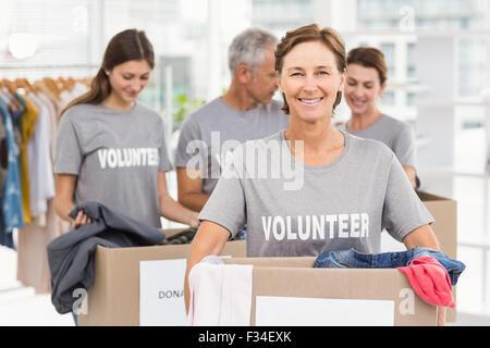 Female volunteer portant donation box