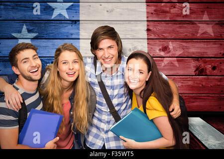Image composite d'élèves au collège du corridor de l'holding folders Banque D'Images