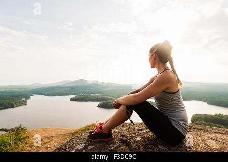 Young female hiker looking at view