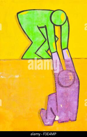 Aider à monter un mur. Banque D'Images