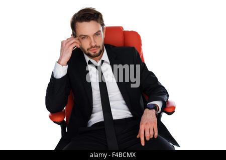 Chat homme inquiet sur son mobile Banque D'Images