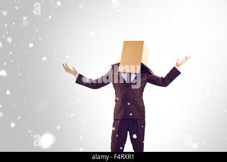Image composite de businessman holding anonyme ses mains Banque D'Images