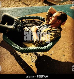 Man relaxing in a chair Banque D'Images