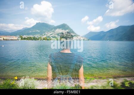 Double exposition reflet de femme en voyant le lac de Lugano, Suisse Banque D'Images