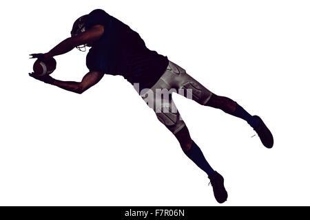 Joueur américain de basket-ball de capture en plein vol Banque D'Images