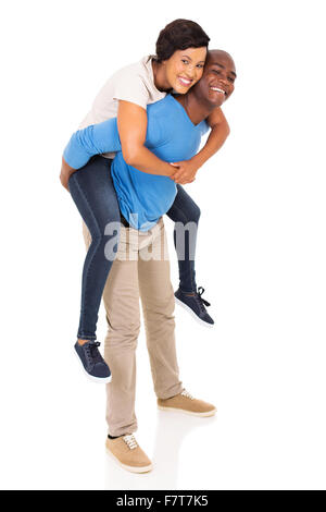 African American couple ludique piggyback sur fond blanc Banque D'Images