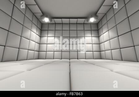 Une cellule capitonnée blanche dans un hôpital psychiatrique Banque D'Images