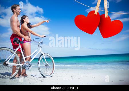 Image composite de l'heureux couple going on a bike ride Banque D'Images