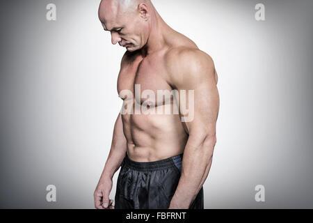 Composite image triste homme chauve à la bas Banque D'Images