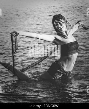 Young Woman Enjoying In Sea