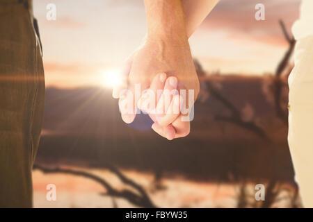 Image composite de happy senior couple holding hands Banque D'Images
