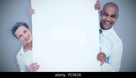 Image composite des gens d'affaires holding blank sign Banque D'Images