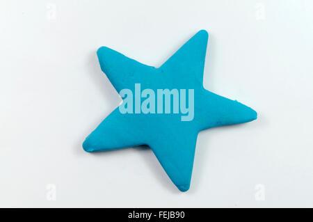 Point cinq étoiles fabriqué à partir de pâte Play-doh. Banque D'Images