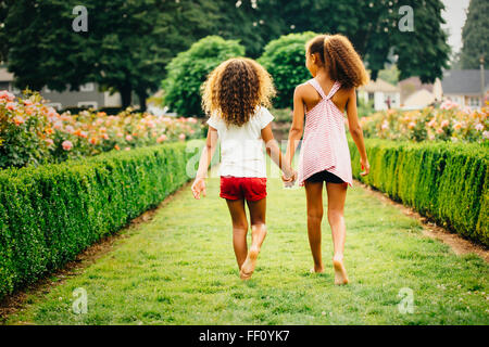 Mixed Race girl walking in garden