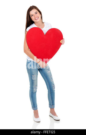 Happy young woman holding big red heart shape Banque D'Images